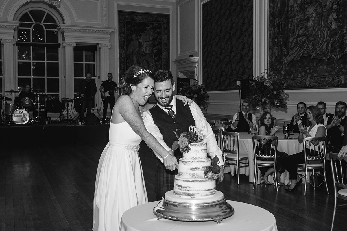 bride and groom cutting wedding cake at Hopetoun House
