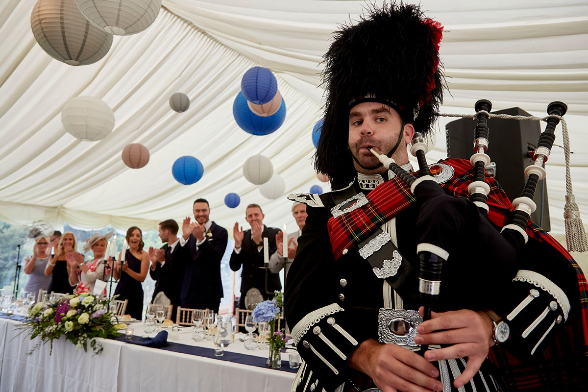 bagpiper and top table at Neidpath Castle