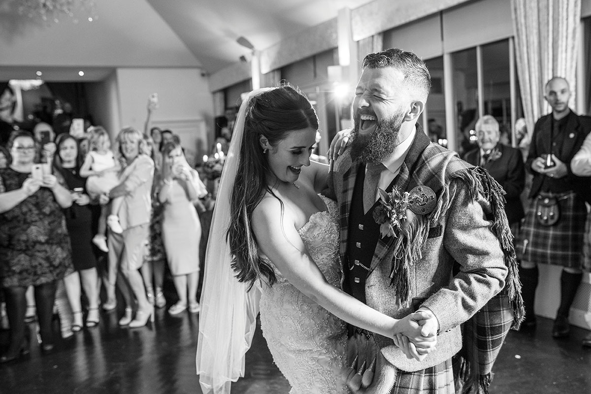irst dance Carlowrie Castle newlyweds laughing