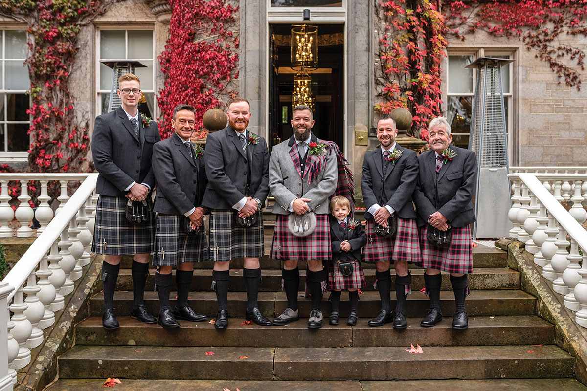 CameraShy-Photography-Carlowrie Castle wedding groom and groomsmen on steps