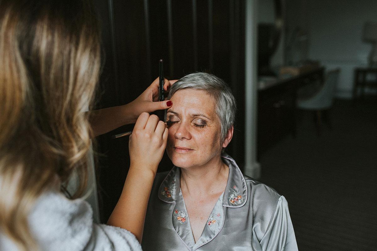Older bride getting makeup done