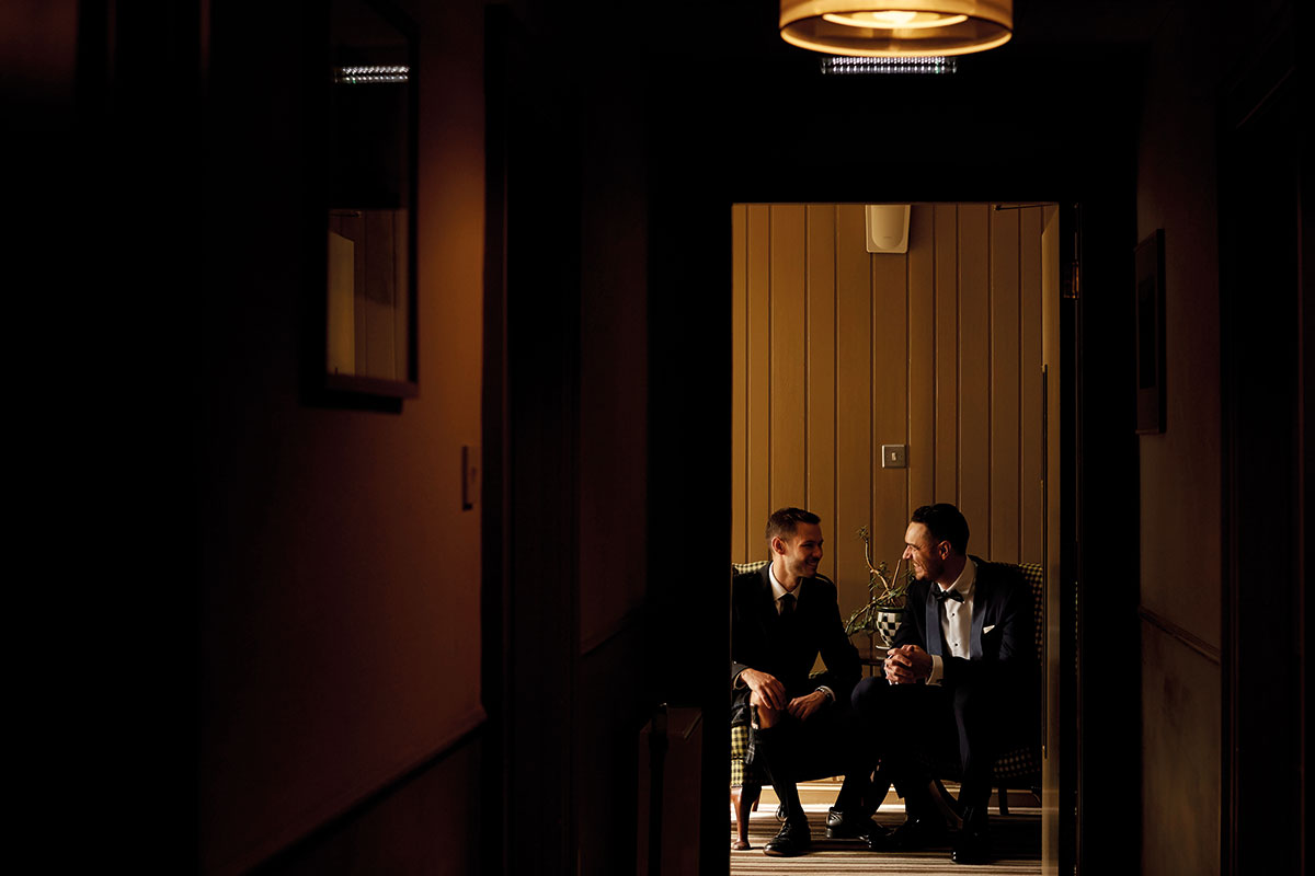 two grooms talking Story of Love Photography Neidpath Castle two grooms wedding