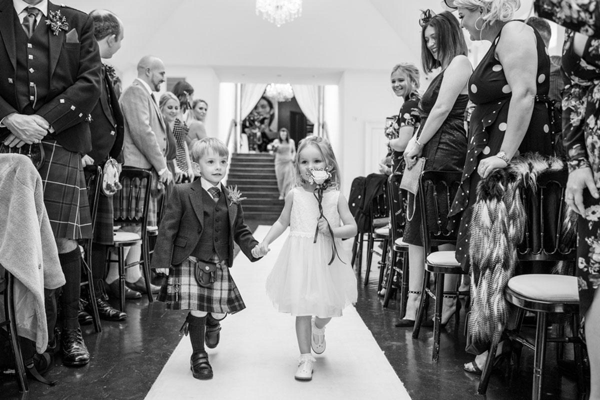 CameraShy Photography Carlowrie Castle wedding flower girl and page boy walk down aisle