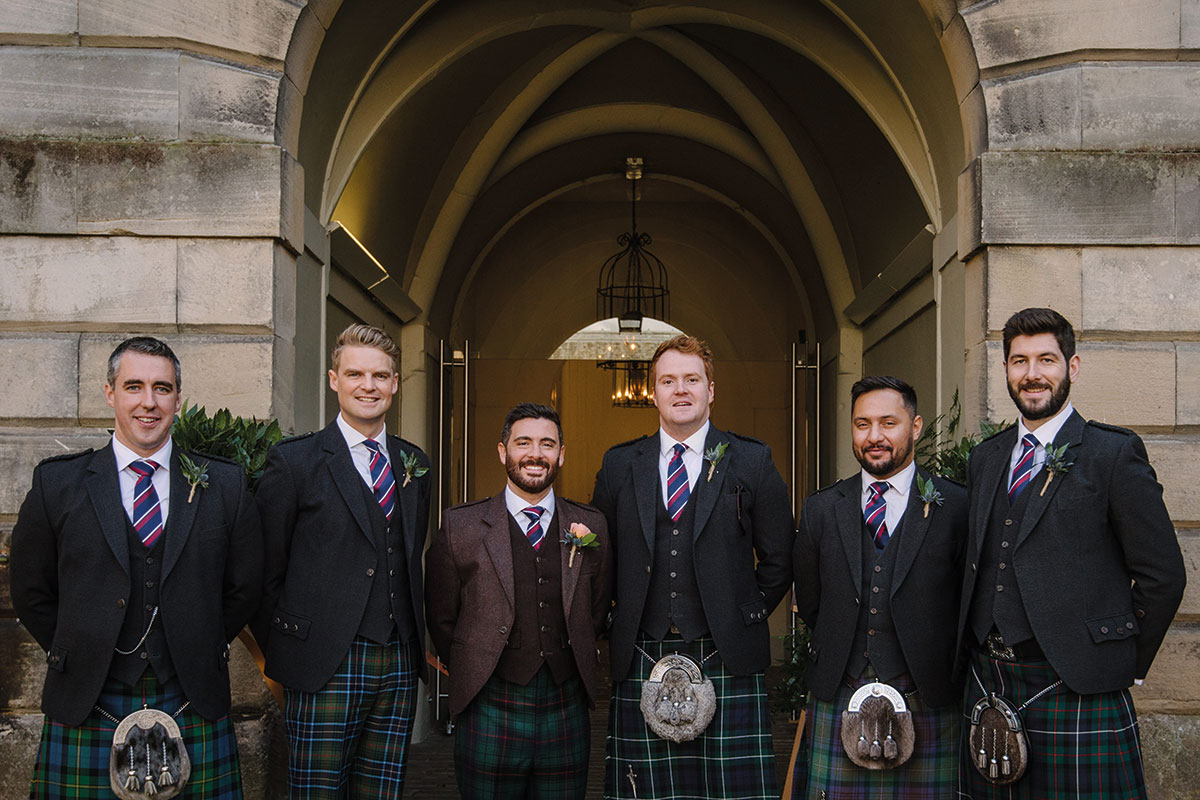 groom and groomsmen outside Hopetoun House