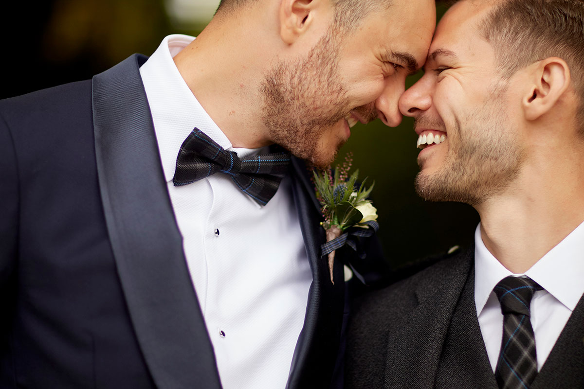 two grooms smiling Story of Love Photography Neidpath Castle wedding