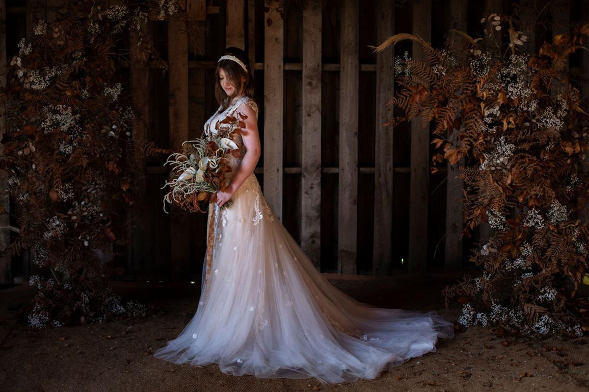 autumn bride in a barn