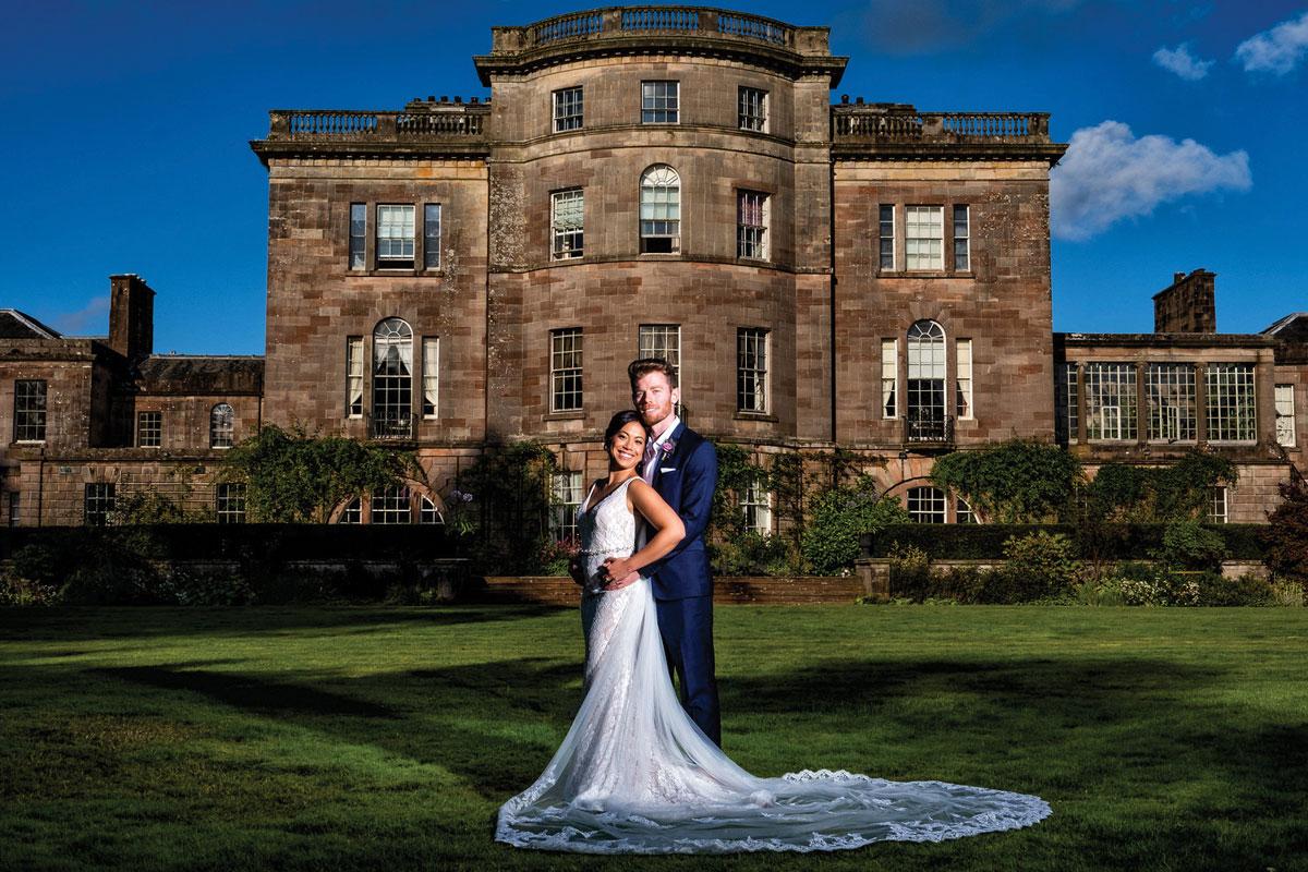 Ardgowan House exterior with bride and groom