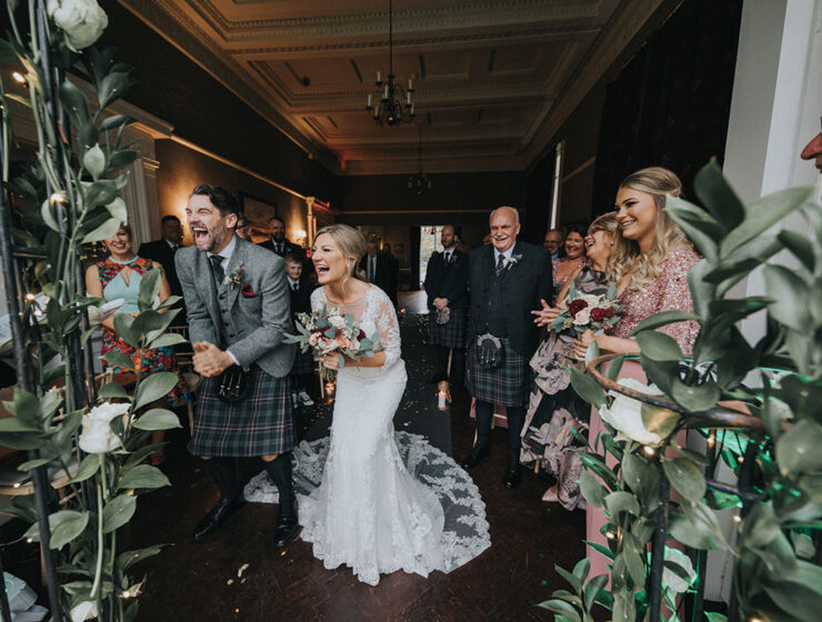 Bride and groom laughing at their ceremony