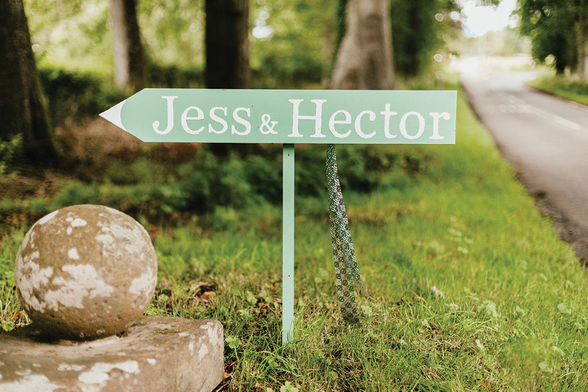 green wedding direction sign