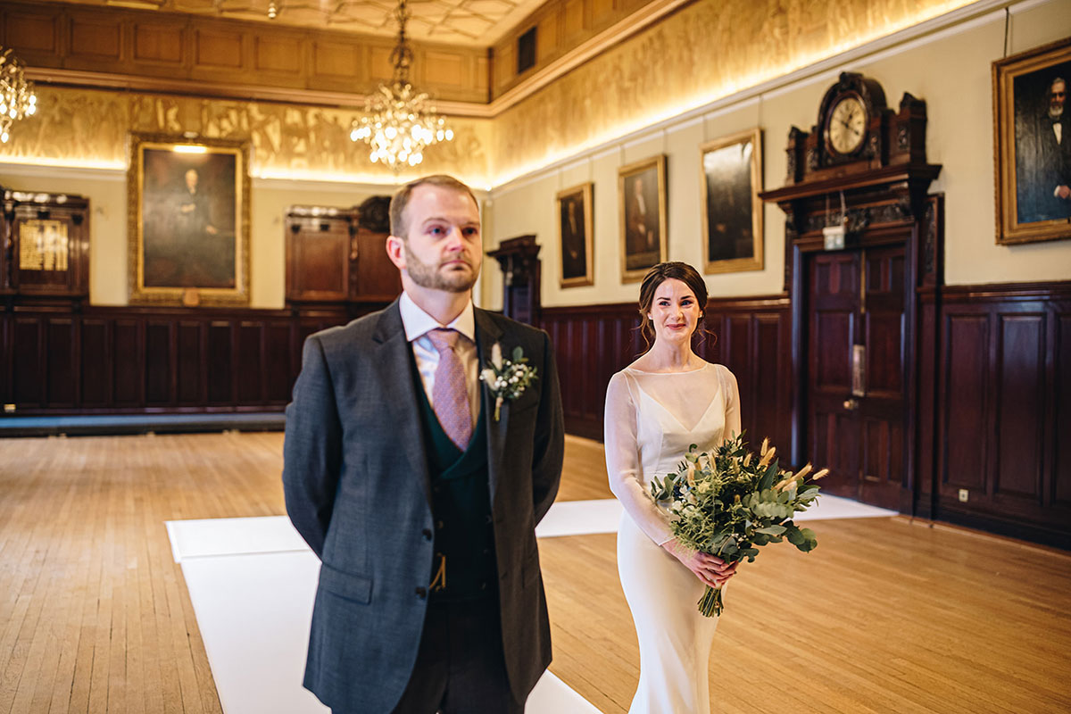 bride walking up aisle to groom at Trades Hall Glasgow elopement
