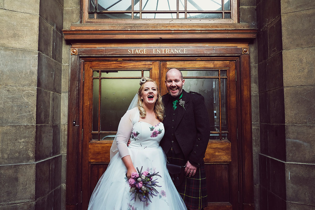 bride and groom outside Leith Theatre