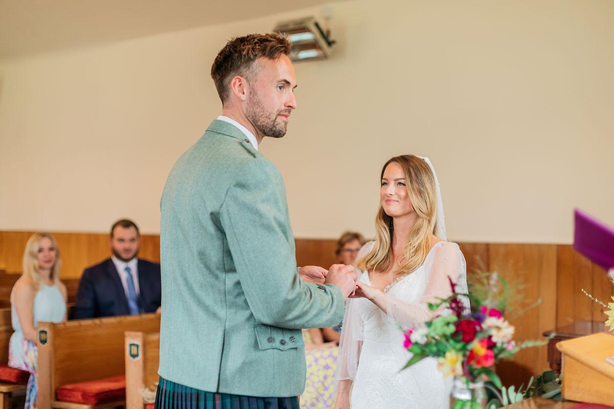 bride and groom wedding ceremony at Clova Kirk