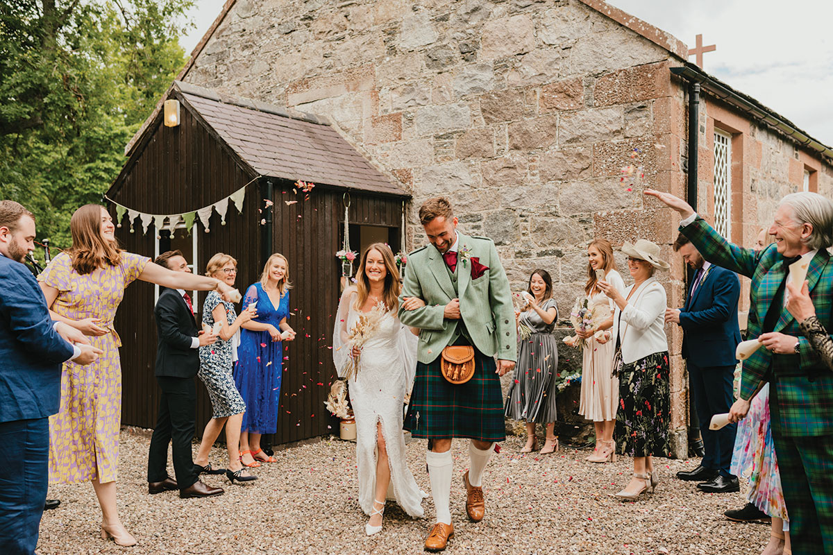 bride and groom being showered in confetti at Clova Kirk