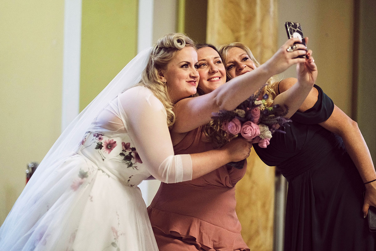 bride and 2 guests taking a selfie at wedding at Leith Theatre