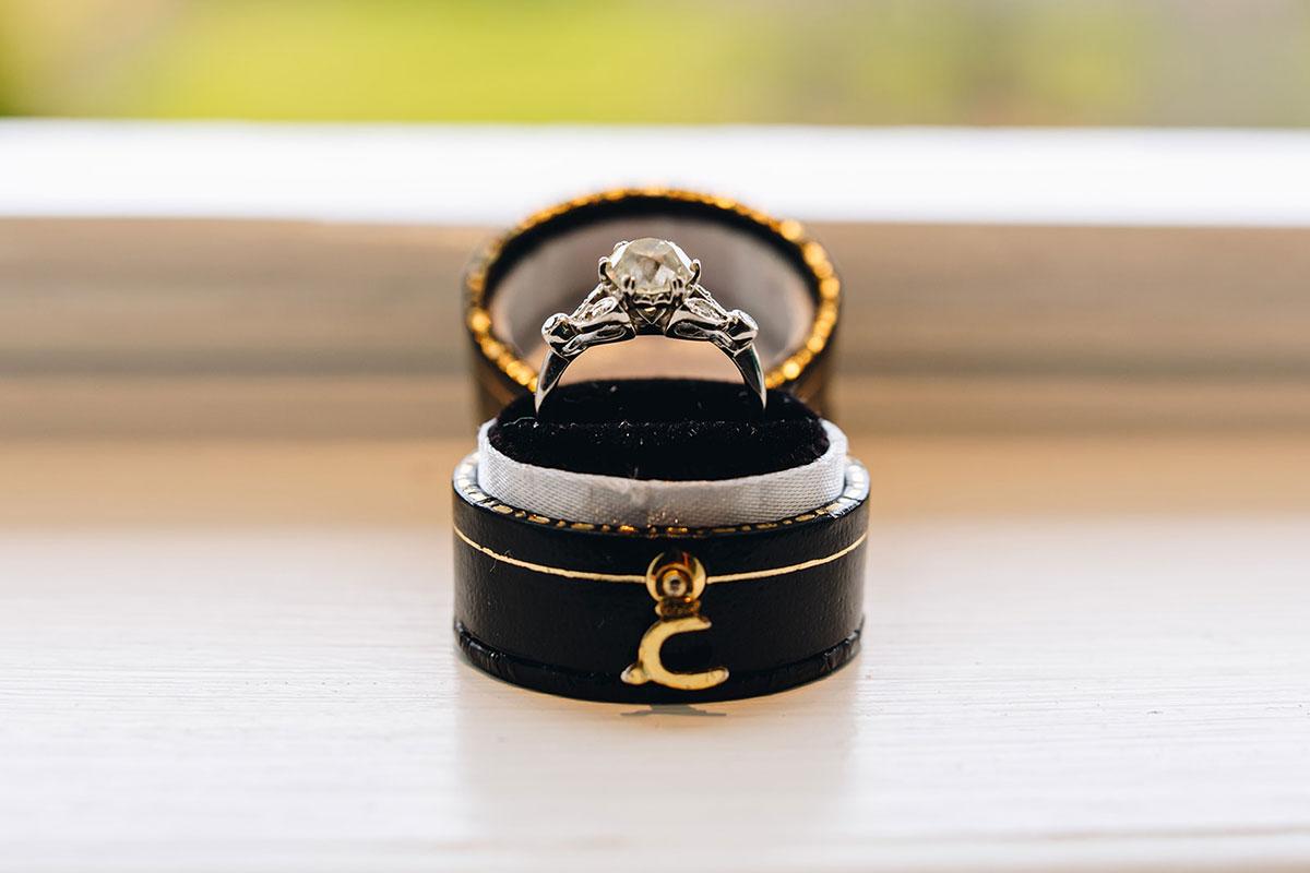 vintage diamond engagement ring in round black box