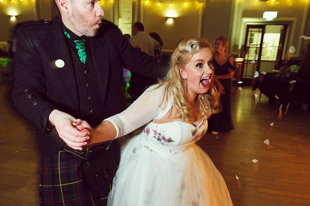 bride and groom ceilidh dancing at Leith Theatre
