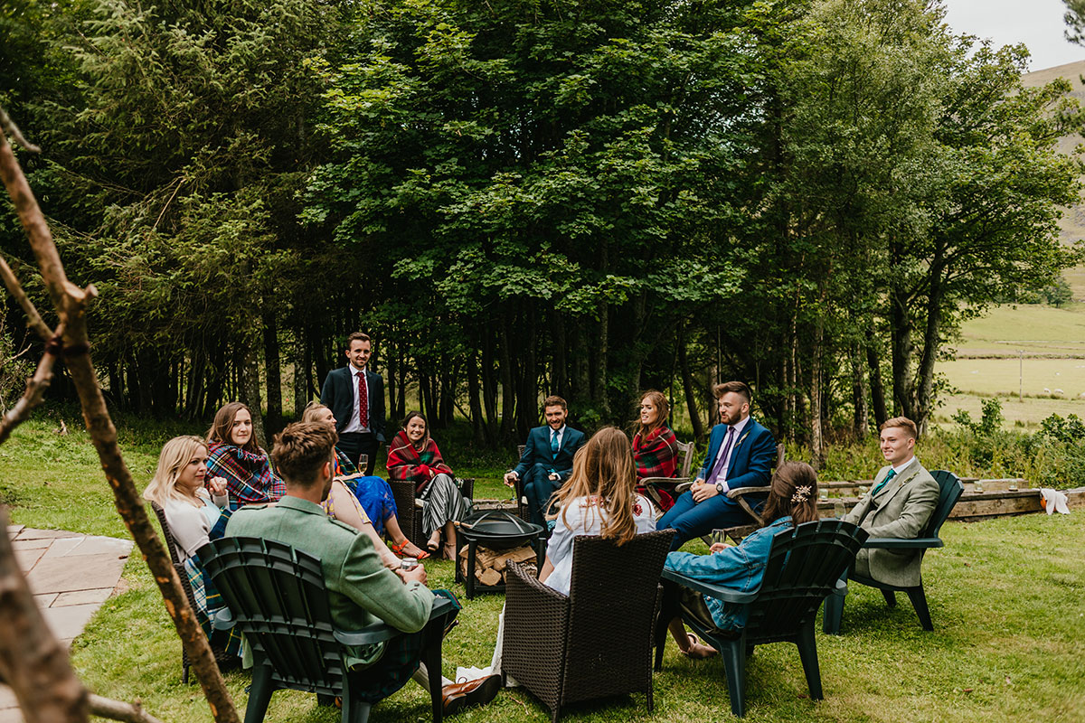 wedding guests sitting outside at Glen Clova