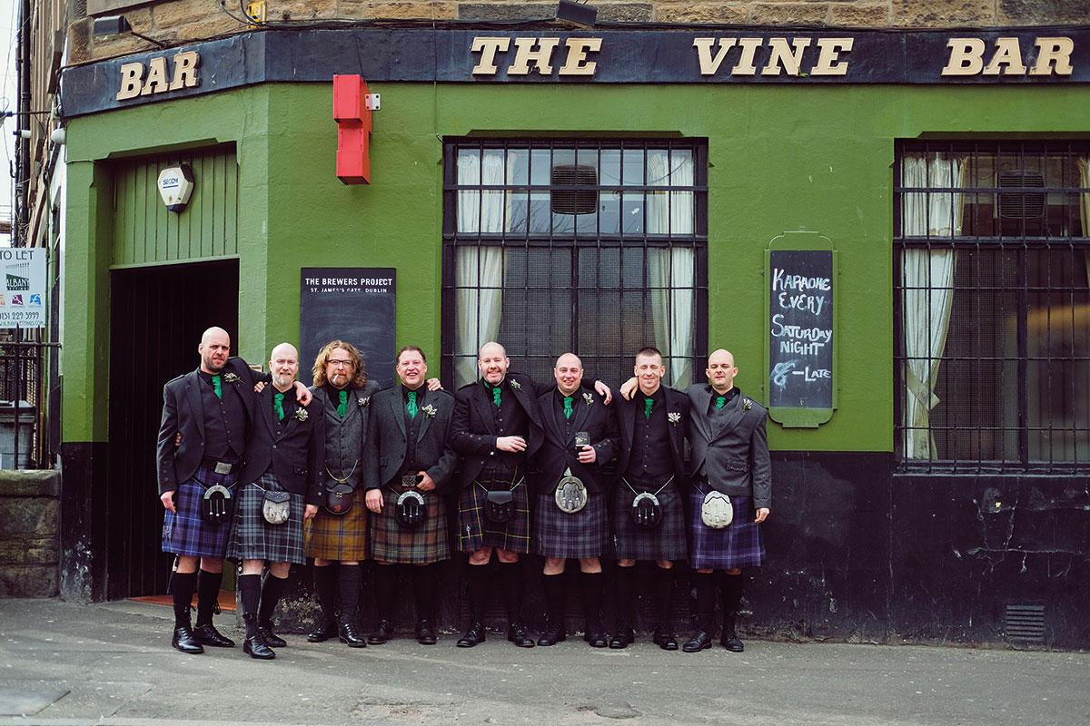 groom and groomsmen wearing kilts outside The Vine Bar Leith