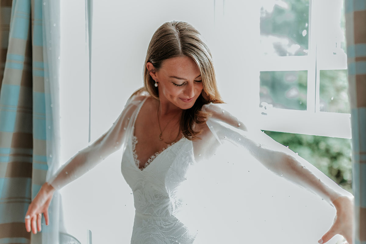 bride wearing pearl cape and wedding dress