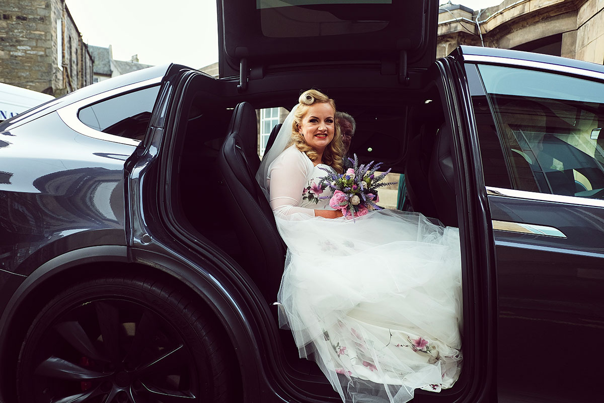 bride arriving at Leith Theatre in sports car