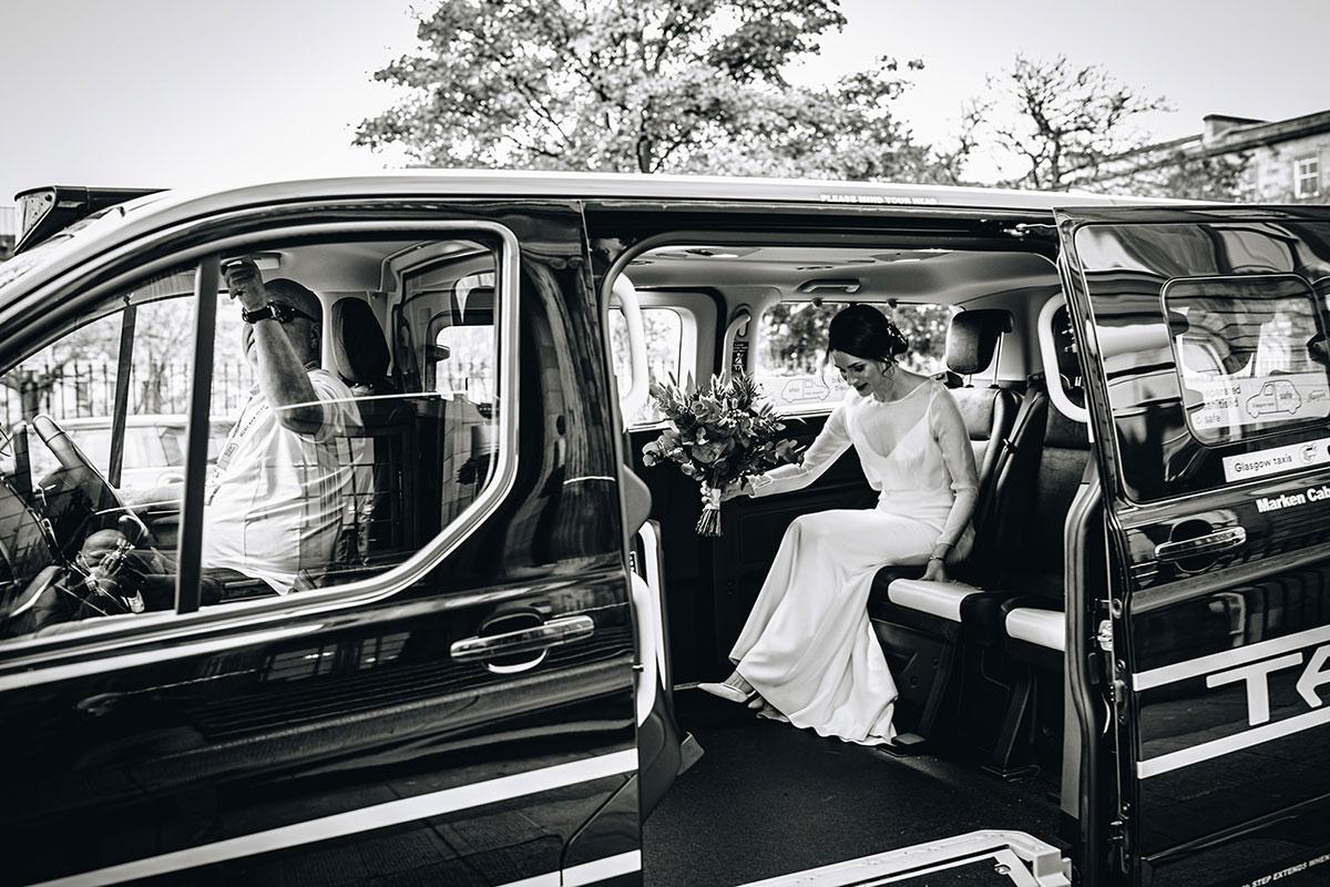 bride in Glasgow black Hackney taxi