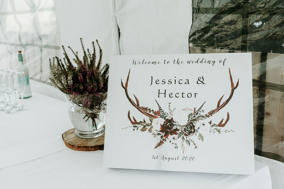 stag and flower illustrated wedding welcome sign