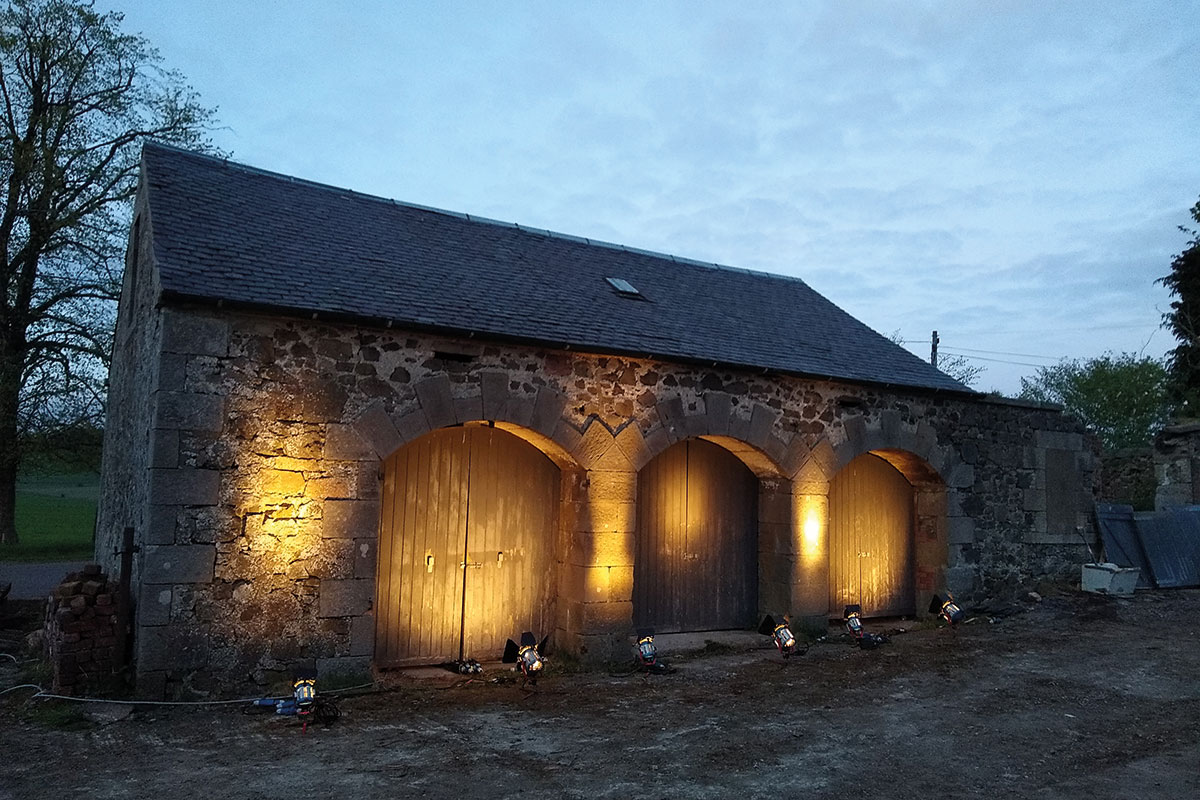 Lit-up barn at dusk at Cormiston Farm