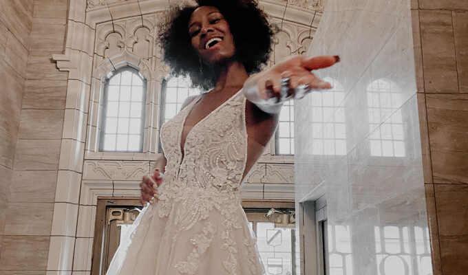 Model wearing style D3151 by Essense of Australia from Kudos Bridal Boutiques Dunfermline