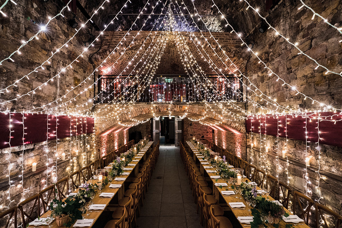 Long table wedding set-up with fairy lights at the Caves in Edinburgh