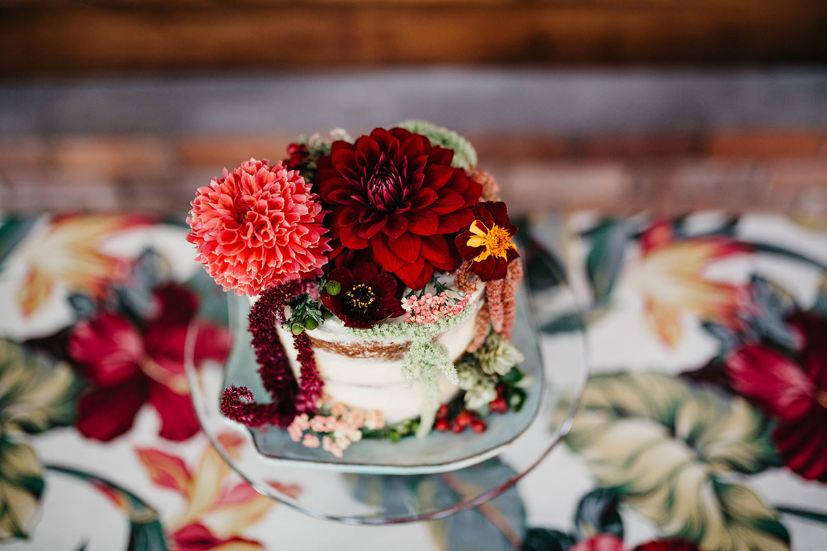 The Elopement Society wedding cake by Liggy's Larder, flowers by Studio Seapink and fabric by Emily Millichip