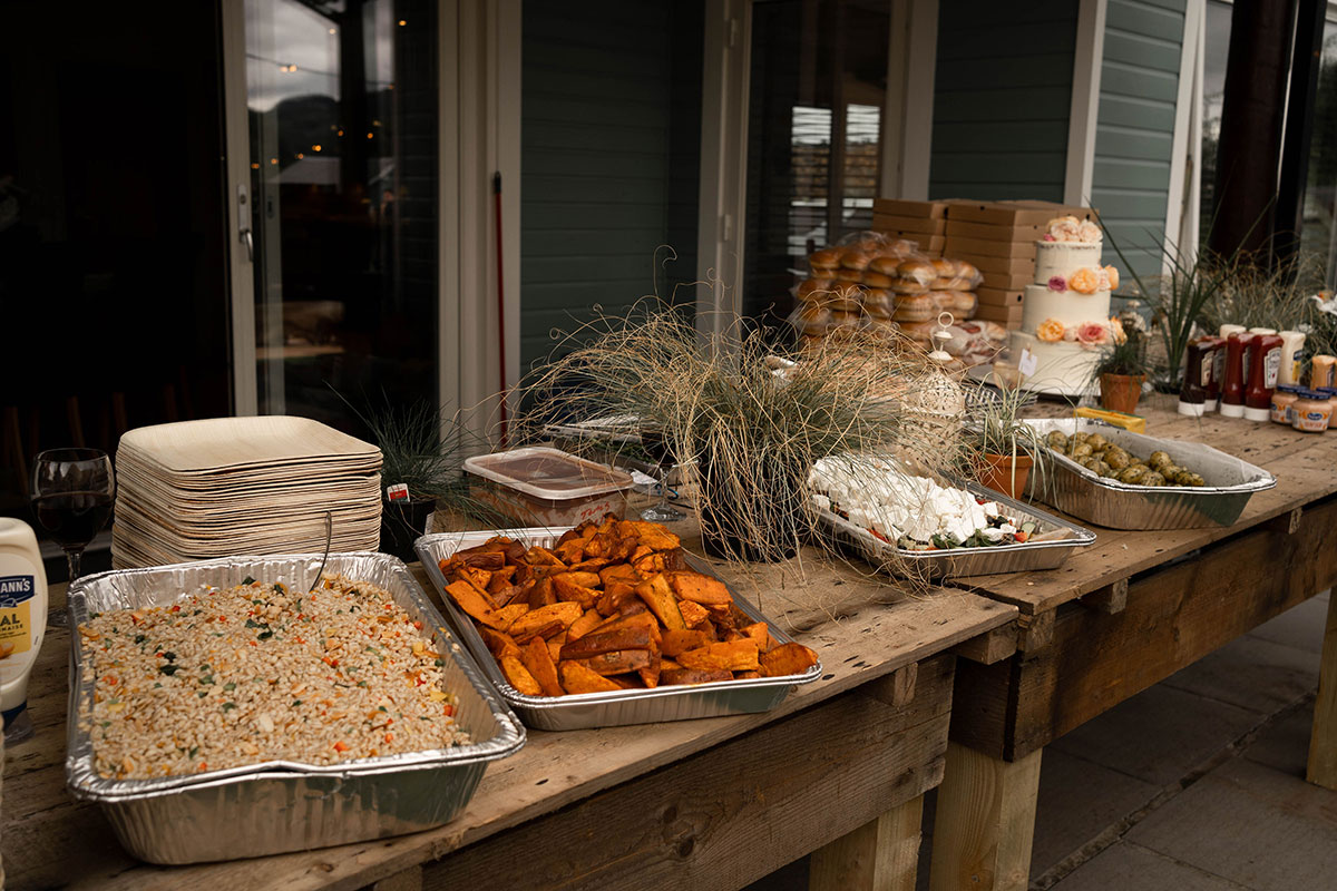 trays of homemade food on a tabletop at an outdoor Perthshire farm wedding