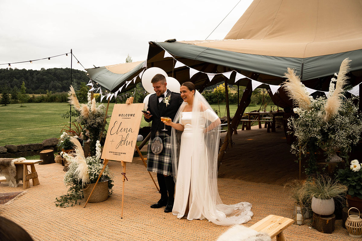 bride and groom making a speech standing outside a Papakata teepee