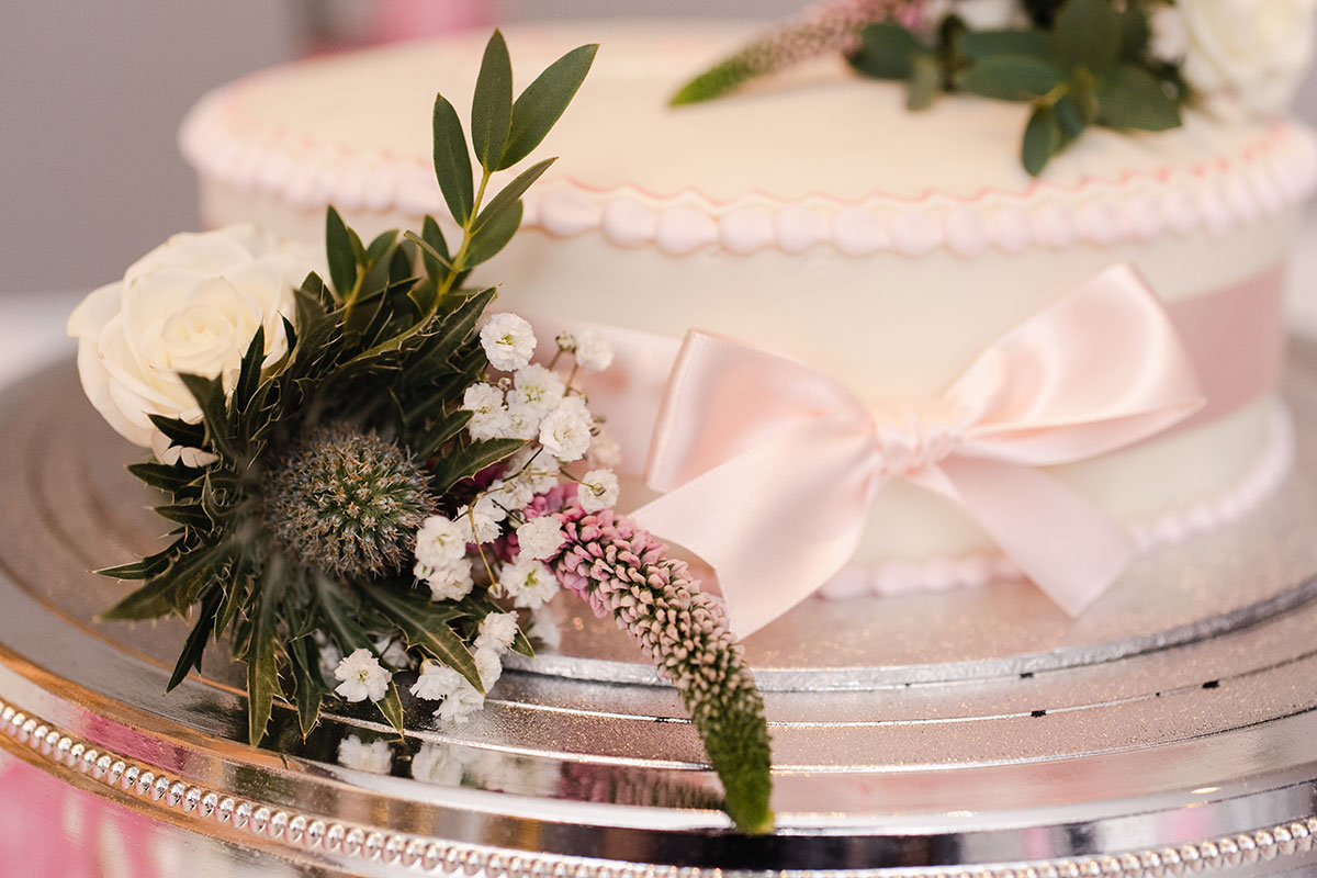 thistle and bow detail on small personalised pink wedding cake from Harry Gow Inverness