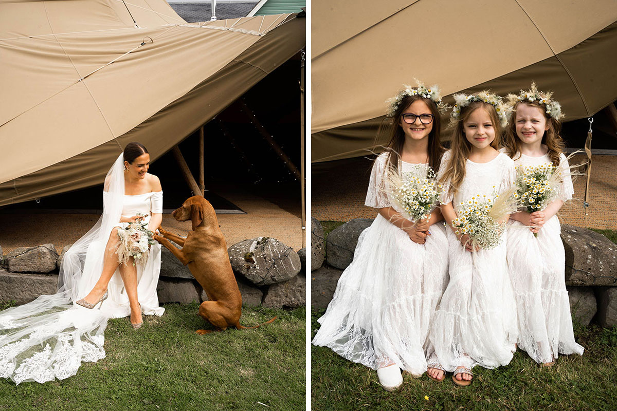 bride sitting with dog giving paw outside wedding teepee and three flower-crown wearing flower girls sitting on wall outside a wedding teepee