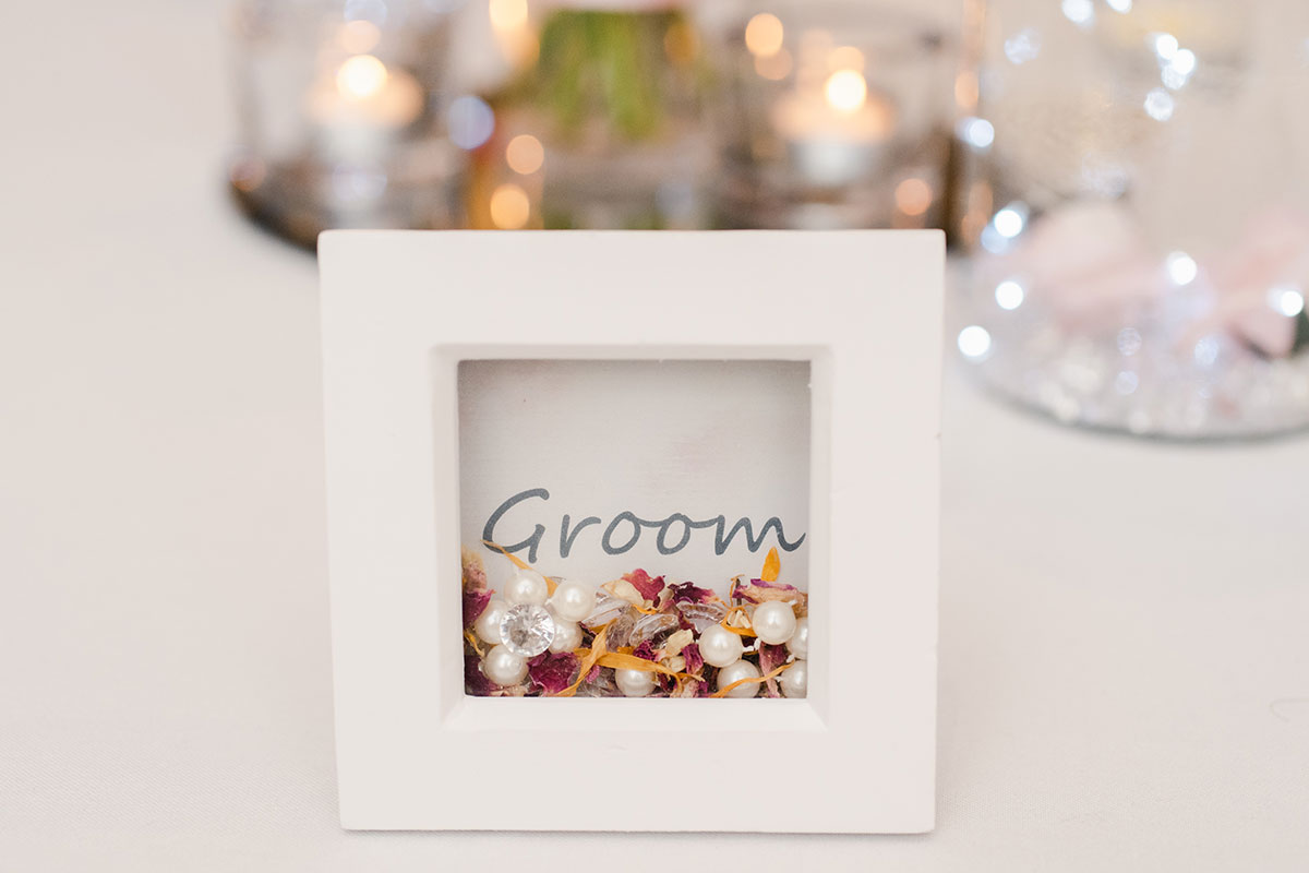 pearl and petal-filled frame groom place setting