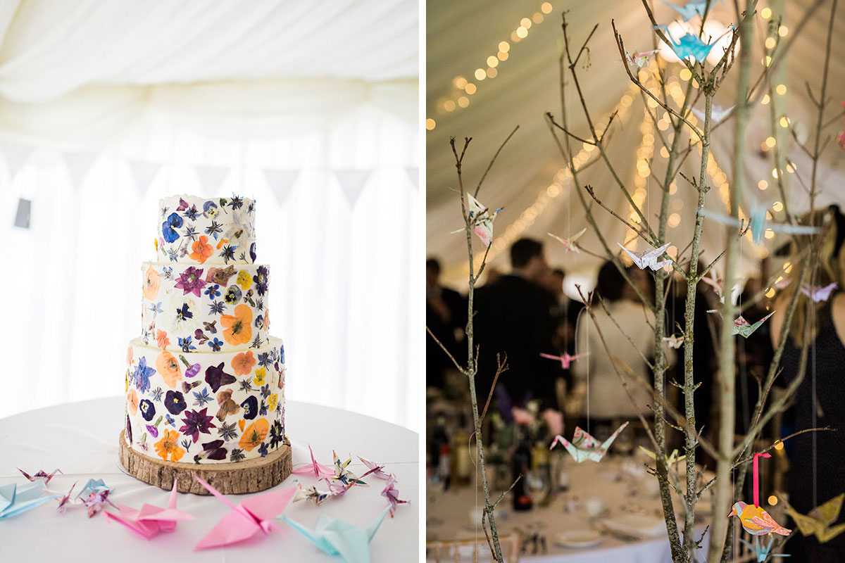 pressed flower wedding cake and branches decorated with origami birds