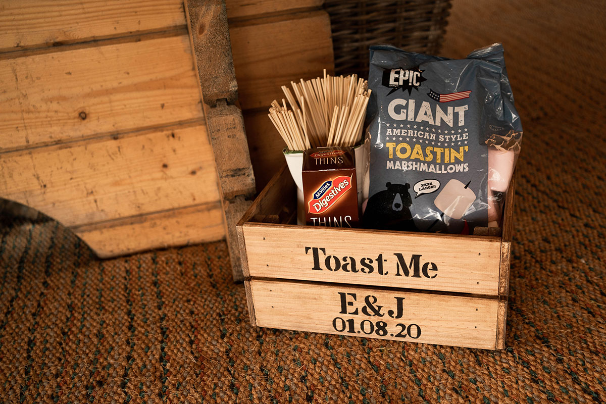 Toast Me personalised marshmallow crate at wedding filled with toasting forks and giant marshmallows