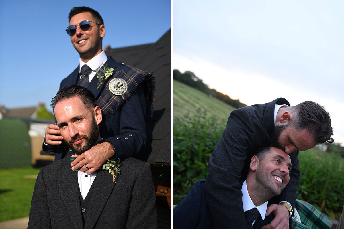 two grooms hugging and kissing outdoors after their wedding