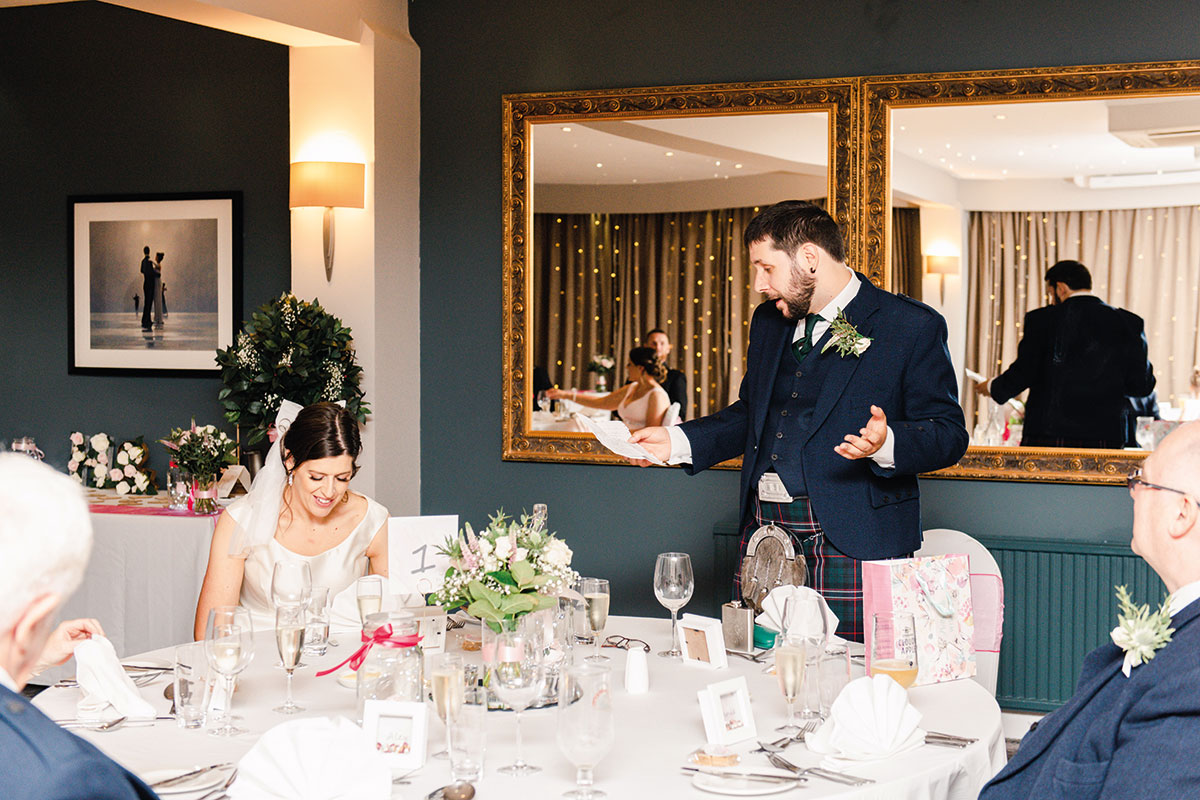 groom making wedding speech at dinner table at Waterside Hotel Inverness