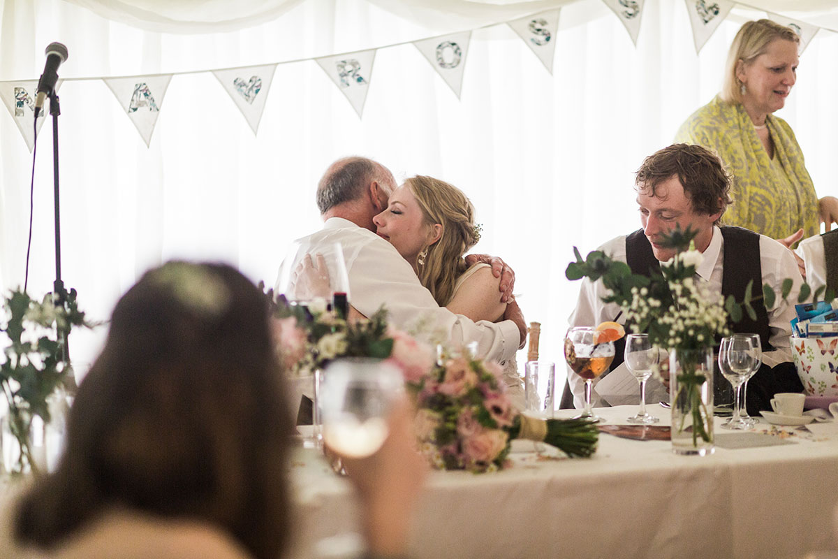 man hugging bride at marquee wedding at Murthly Castle