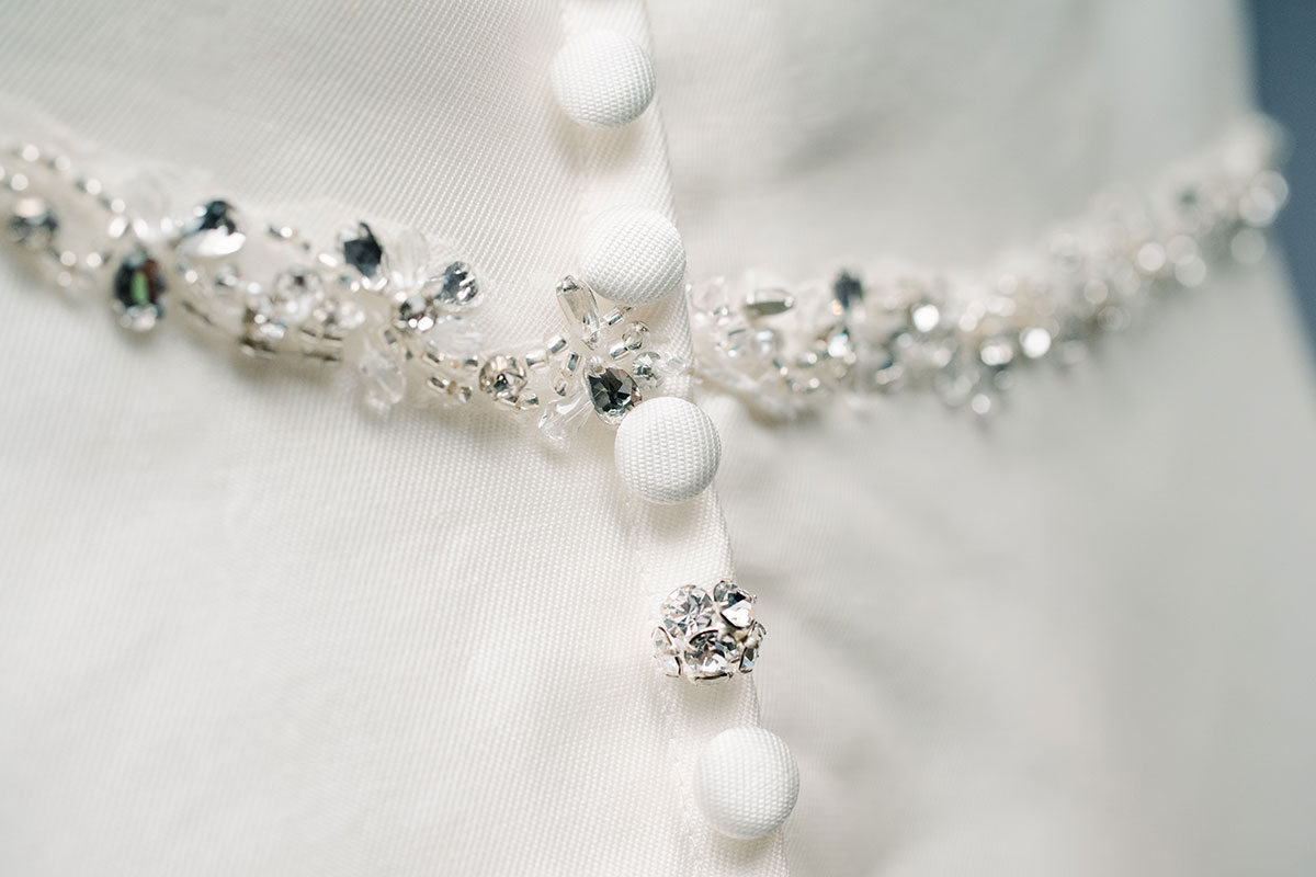 buttons and crystal detail on back of wedding dress
