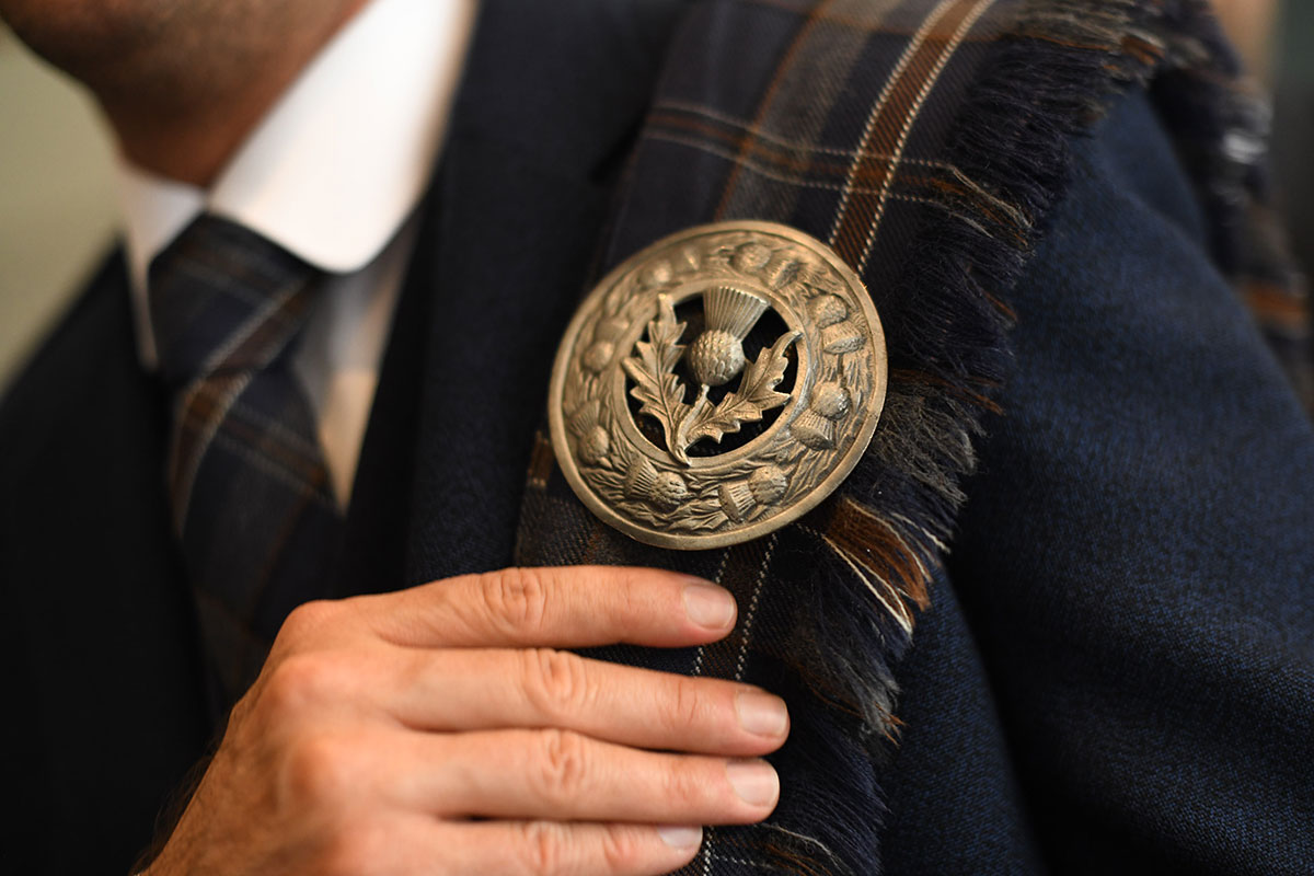 silver thistle badge on tartan fly plaid by MacGregor and MacDuff