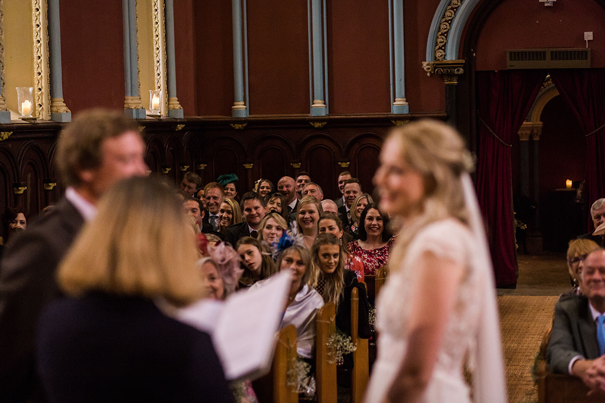 wedding ceremony at Murthly Castle with guests looking on