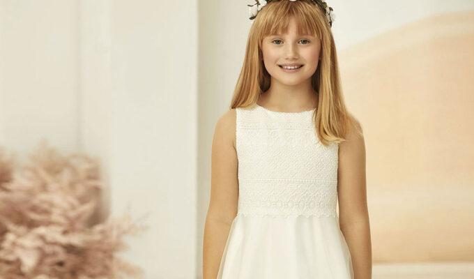 Model wearing Bianco Evento flower girl dress