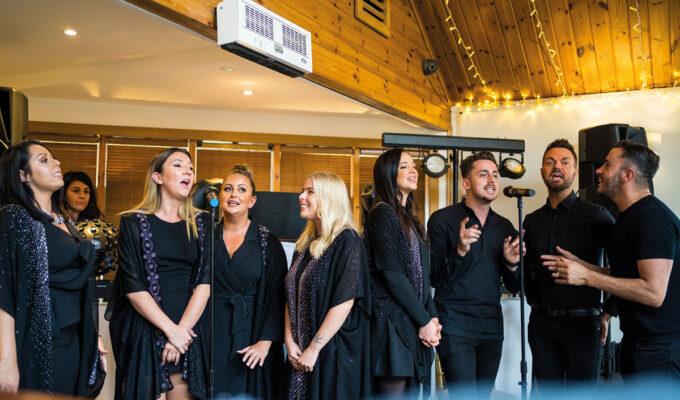 GeO Gospel Choir in studio singing into microphones