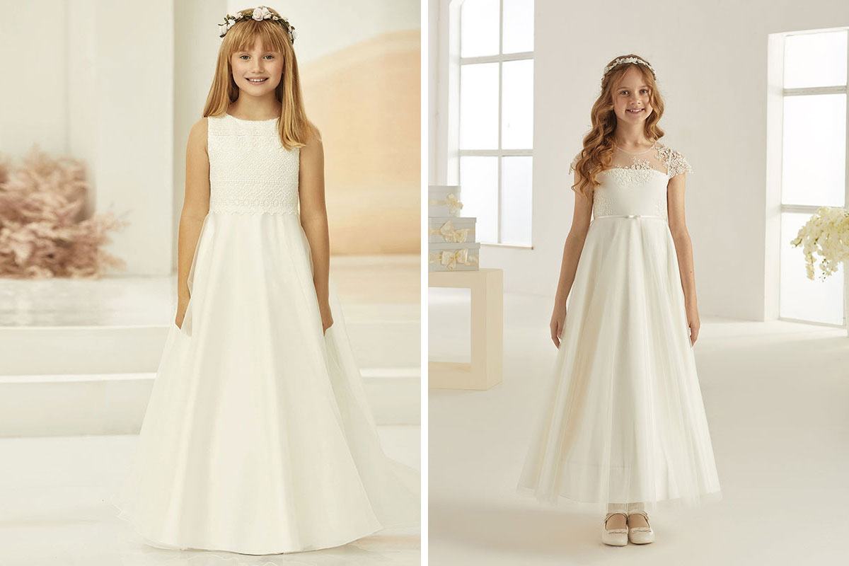 Two models wearing Bianco Evento flower girl and communion dresses