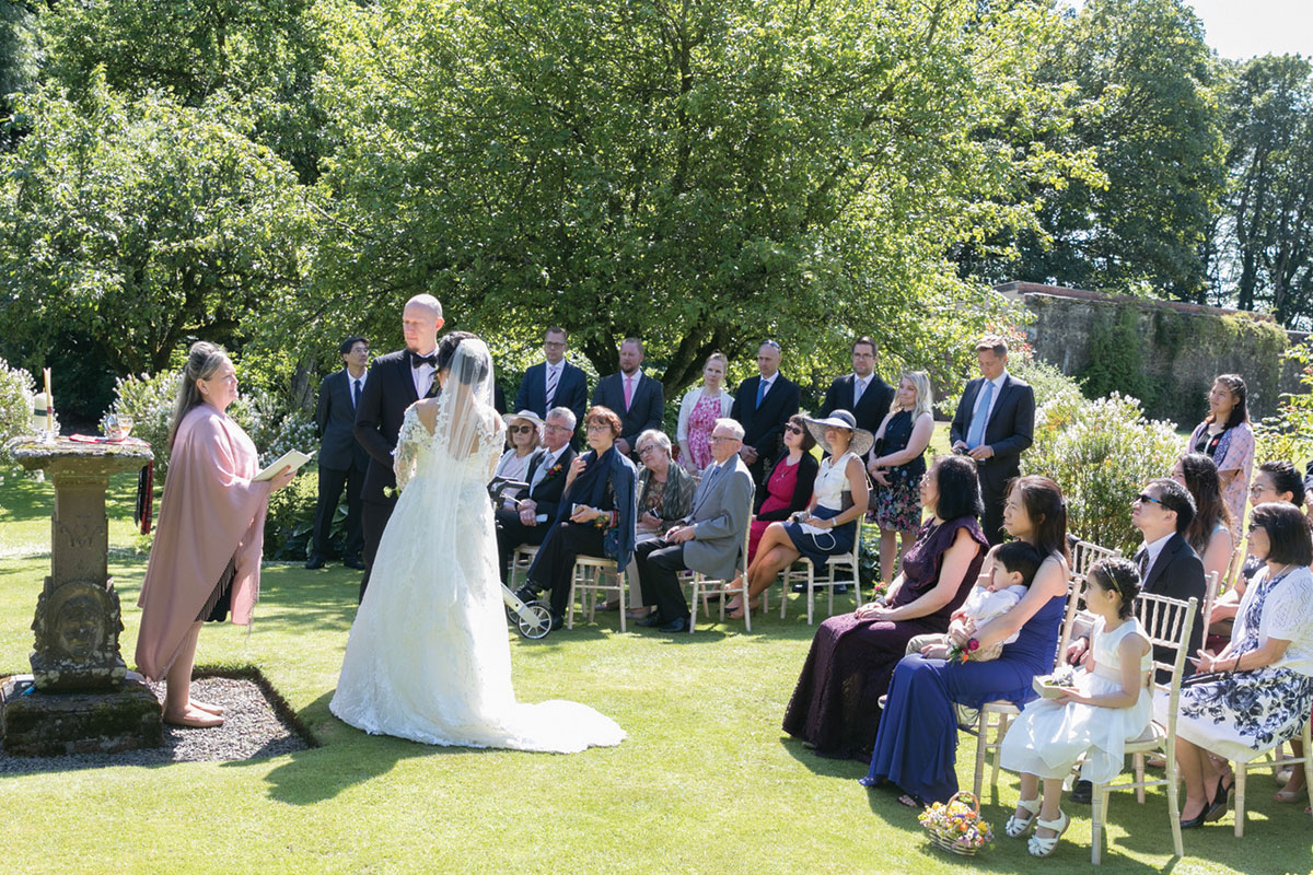 Outdoor wedding ceremony of bride and groom led by celebrant Barbara Campbell
