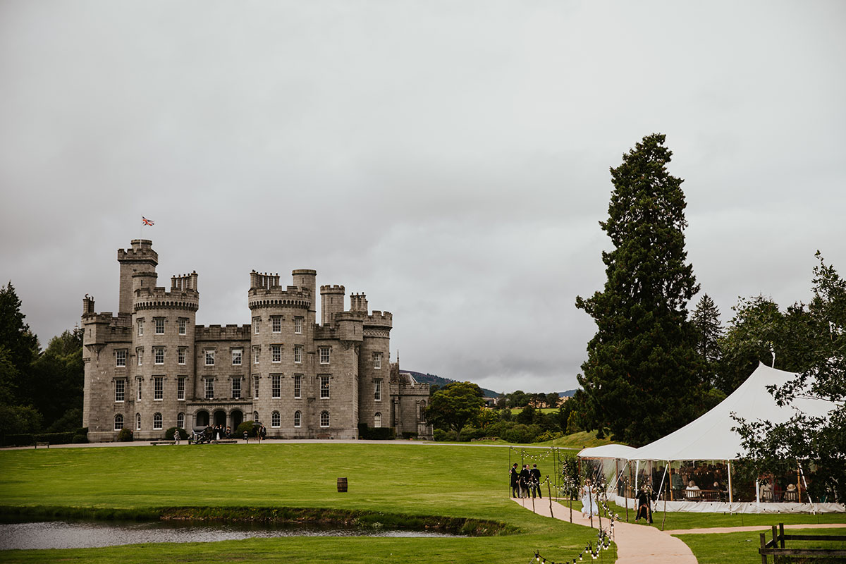 Exterior of Cluny Castle in Aberdeenshire with wedding marquee in grounds