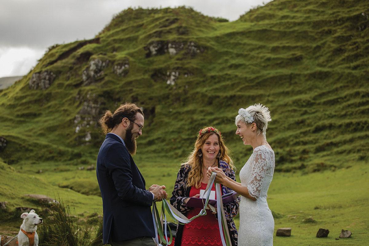 Celebrant Davina McCluskie performing wedding ceremony of bride and groom on Skye