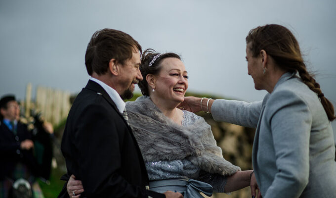 Celebrant Davina McCluskie hugging bride during wedding ceremony of bride and groom on Skye